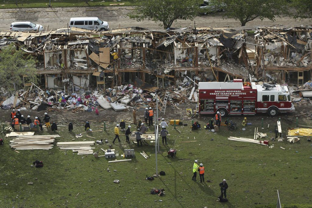 Search and rescue workers combed through what remained of a 50-unit apartment building the day after the explosion.