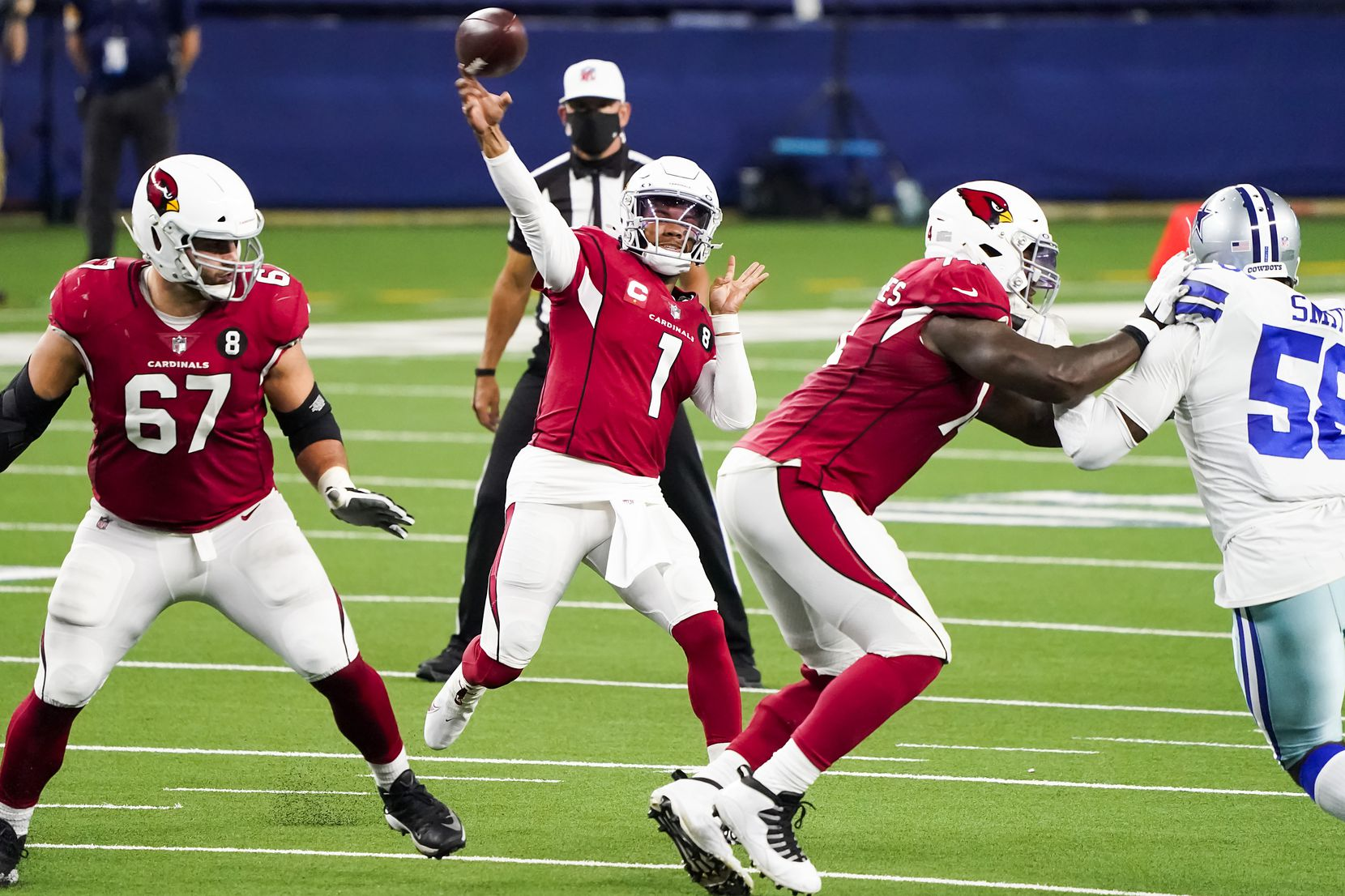 Arizona Cardinals quarterback Kyler Murray (1) throws a pass over Dallas Cowboys defensive end Aldon Smith (58) during the second quarter of an NFL football game at AT&T Stadium on Monday, Oct. 19, 2020, in Arlington. (Smiley N. Pool/The Dallas Morning News)