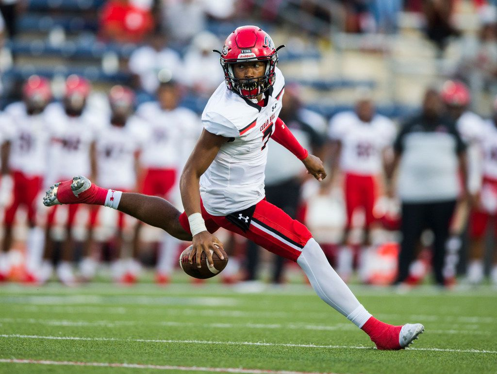 Cedar Hill quarterback Kaidon Salter scrambles during the first quarter of the season opener against Allen on Friday, August 30, 2019 at Eagle Stadium in Allen.