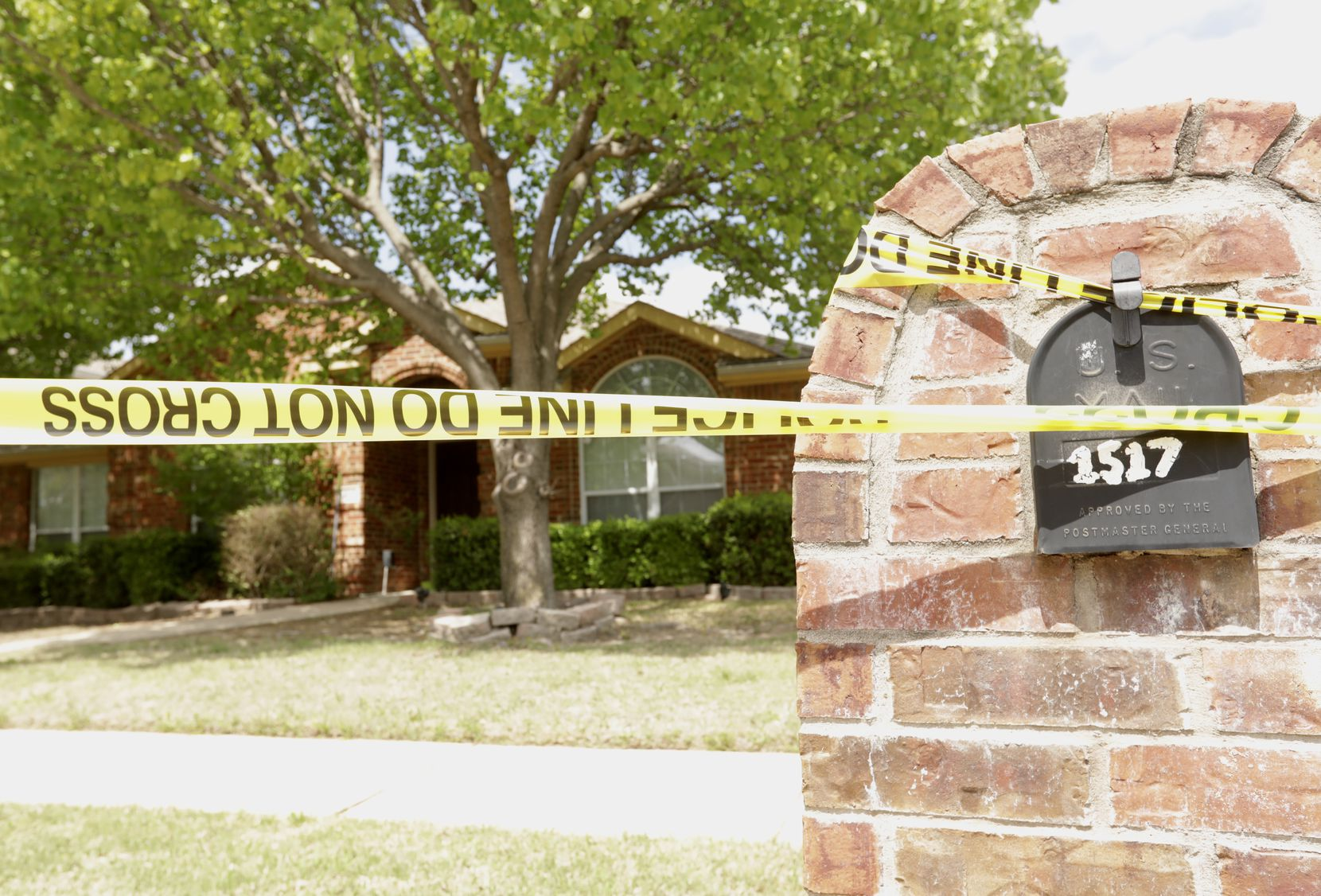 Police tape was wrapped outside the home on Pine Bluff Drive on Monday.