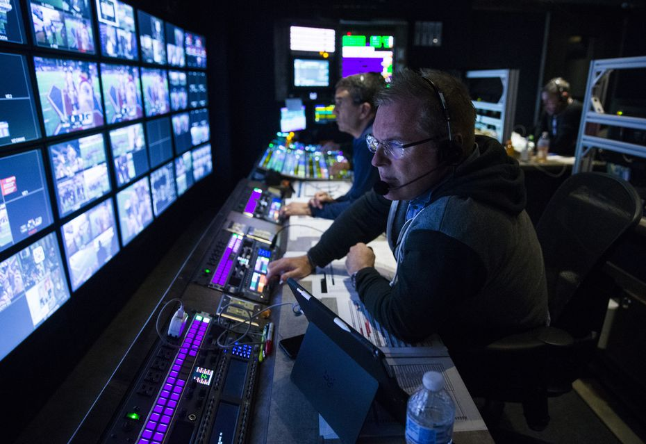 FOX Sports' Chuck McDonald (right) and Rich Russo (center) work in the control room during an XFL game between the Dallas Renegades and the New York Guardians on Saturday, March 7, 2020 at Globe Life Park in Arlington. (Ashley Landis/The Dallas Morning News)