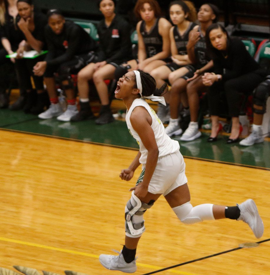 DeSoto's Ash'a Thompson (25) lets out a yell after sinking a shot against Cedar Hill on January 18, 2019. (Steve Hamm/ Special Contributor)