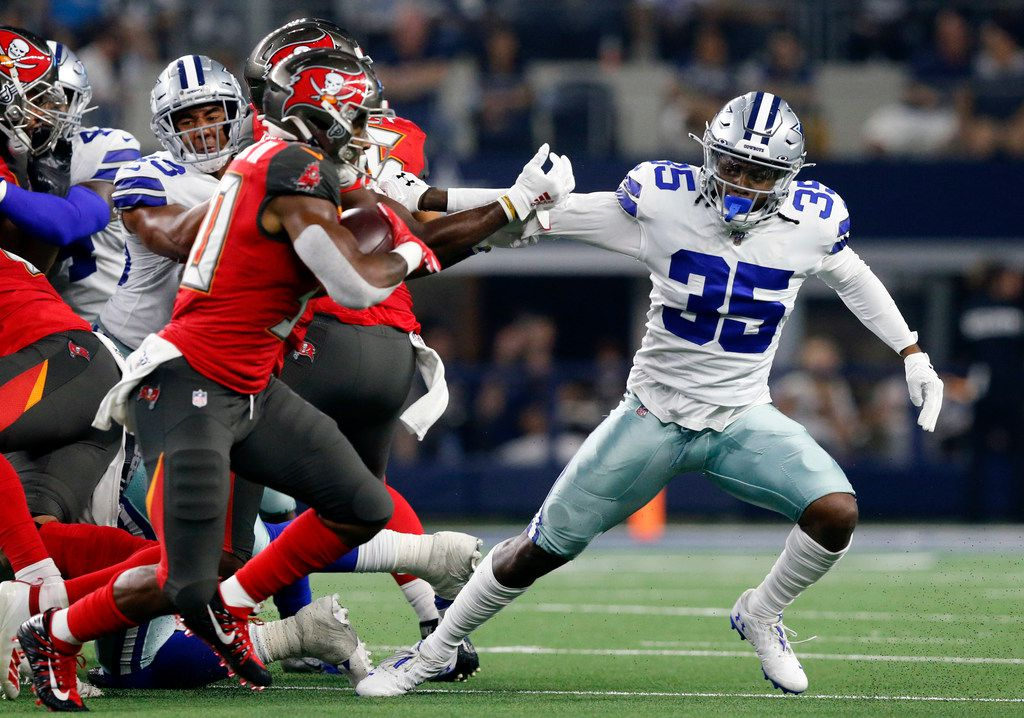 FILE - Cowboys free safety Kavon Frazier (35) chases Tampa Bay Buccaneers wide receiver Scott Miller (10) during the second half of a preseason game at AT&T Stadium in Arlington on Thursday, Aug. 29, 2019.