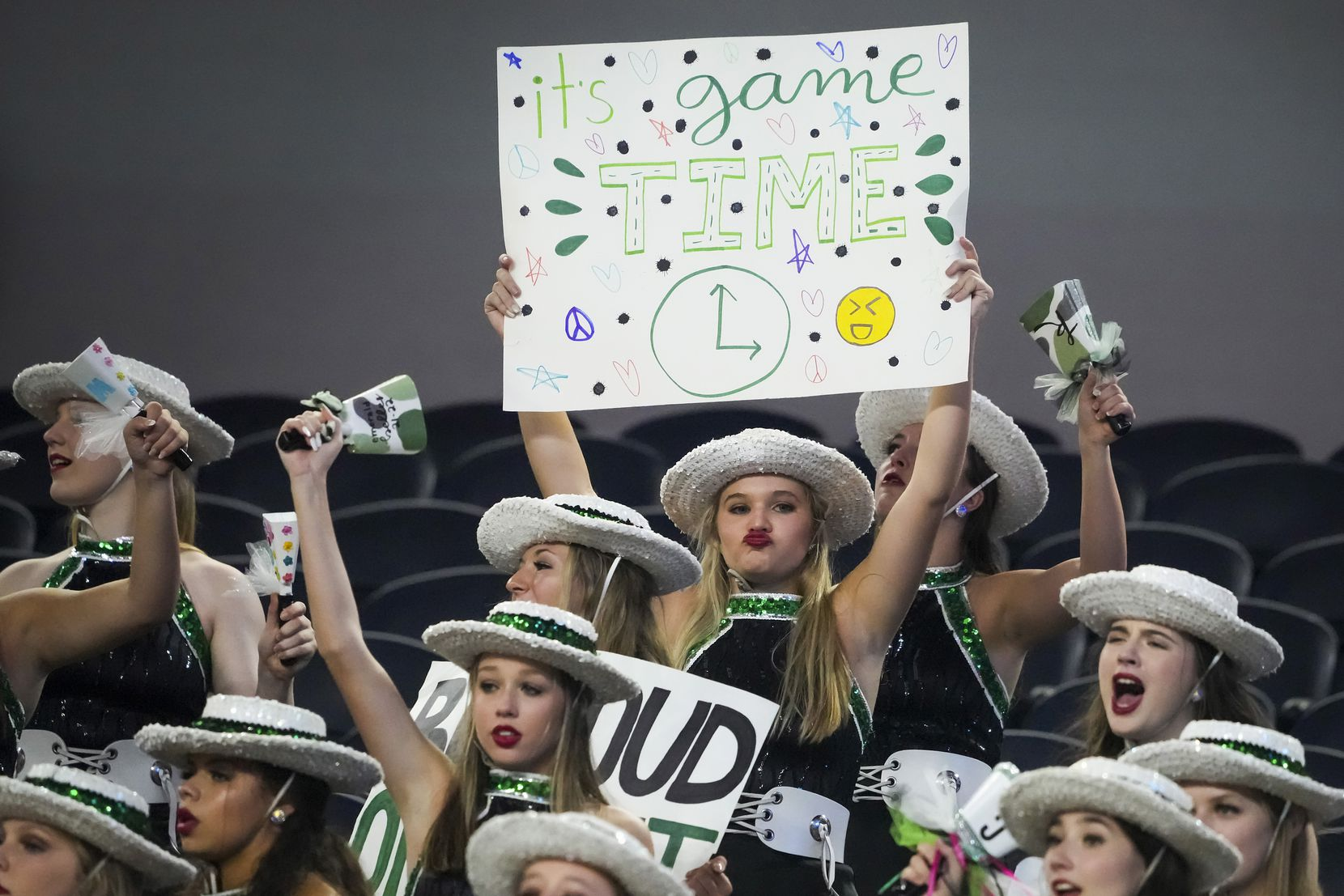 Members of the Southlake Carroll Emerald Belles Drill Team cheer their team during the second half of a high school football game against Highland Park at AT&T Stadium on Thursday, Aug. 26, 2021, in Arlington.