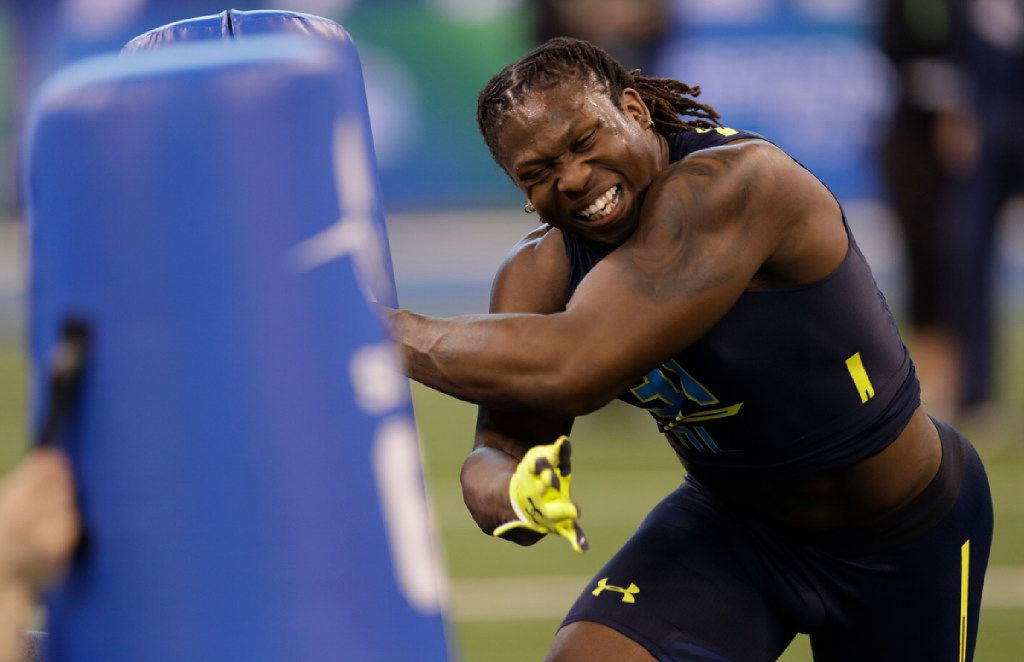 UCLA defensive end Takkarist Mckinley runs a drill at the NFL football scouting combine Sunday, March 5, 2017, in Indianapolis. (AP Photo/David J. Phillip)