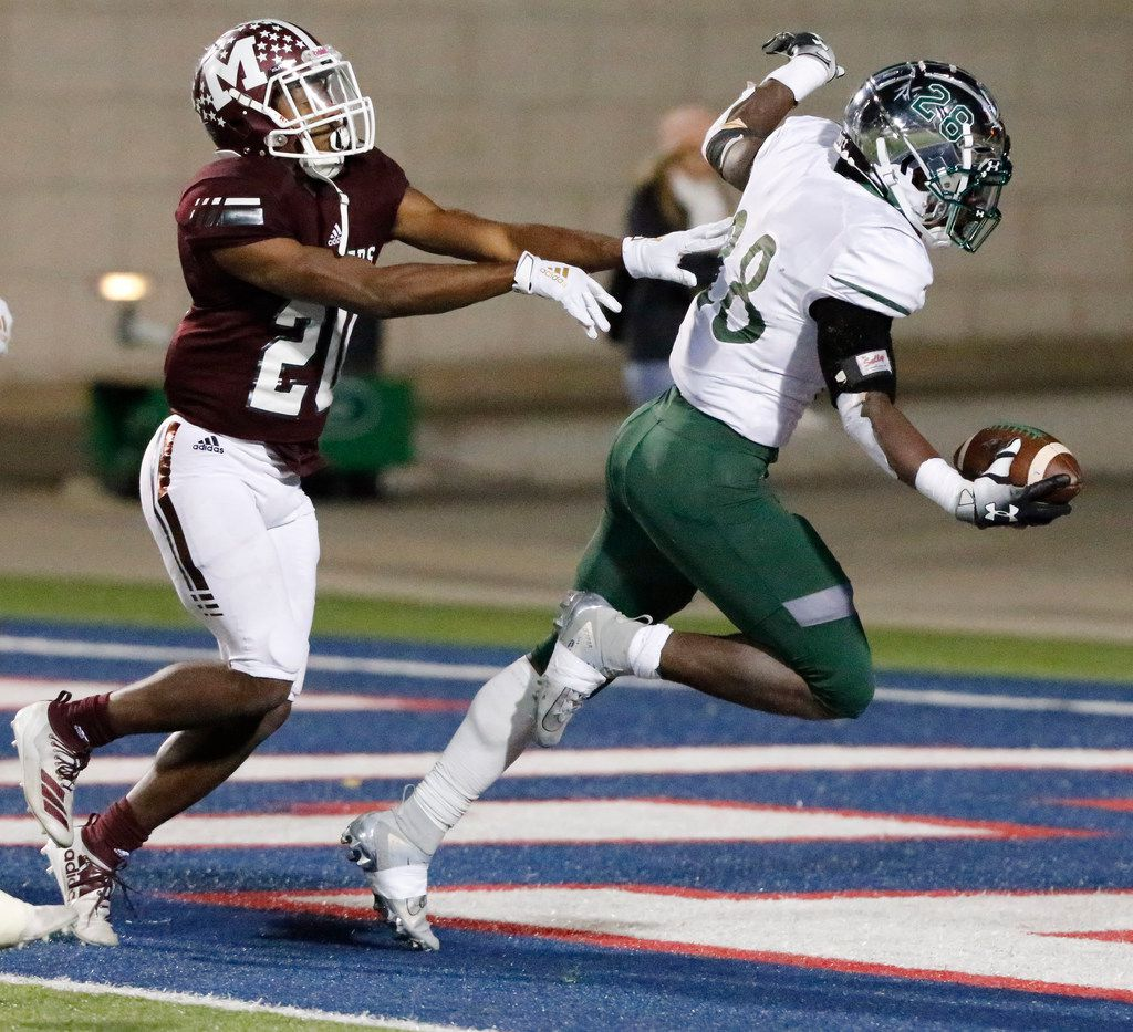 Prosper High School running back JT Lane (28) scores a touchdown near the end of the game while Mesquite High School cornerback Reggie Reese (20) defends as Prosper High School hosted Mesquite High School in a Class 6A Division I area-round playoff game at Eagle Stadium in Allen on Friday night, November 22, 2019. (Stewart F. House/Special Contributor)