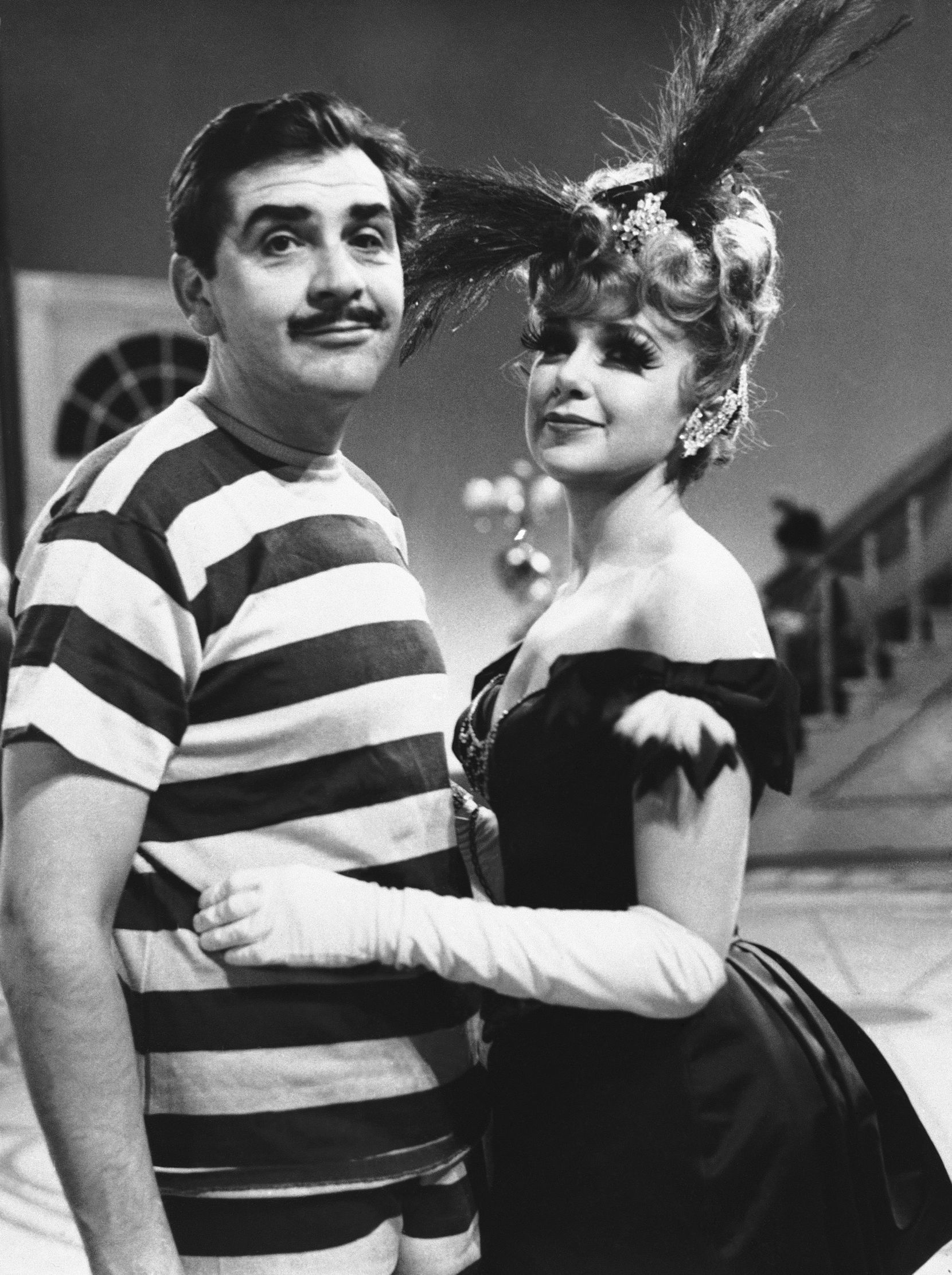 "In this Feb. 22, 1961 file photo, TV comedian Ernie Kovacs, left, and Edie Adams, his wife, appear on the set of ""Private Eye Private Eye."" Kovacs once said, ""Television is a medium because it is neither rare nor well done."""