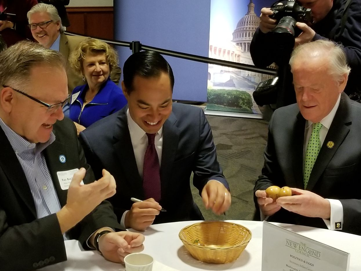 Julián Castro autographs wooden eggs at the Politics & Eggs breakfast on Wednesday, Jan. 16, 2019, at St. Anselm College in Goffstown, N.H. The breakfast was hosted by the college's Institute of Politics and The New England Council, a business group. At left, Ray Buckley, chairman of the New Hampshire Democratic Party.