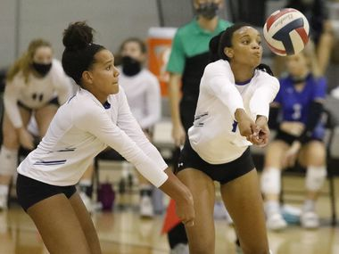 Denton Guyer High School middle hitter Jordyn Williams (7) and Denton Guyer High School outside hitter Kyndal Stowers (5) avoid a collision going for a serve during game two as Denton Guyer High School hosted Flower Mound High School on Tuesday, September 22, 2020.