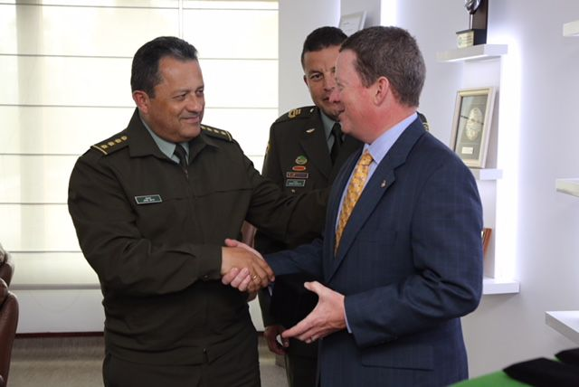 U.S. Attorney Joe Brown is greeted by General Jorge Hernando Nieto Rojas of the Colombian National Police.
