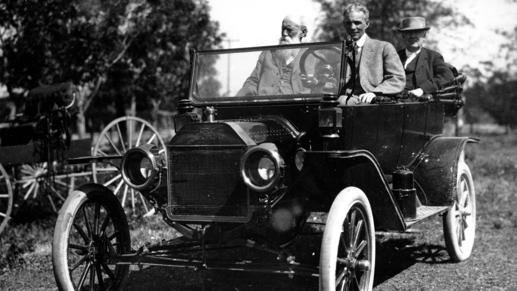 American industrialist Henry Ford (at the wheel) and inventor Thomas Edison, seated in the back, are seen on one of Ford's automobiles at an unknown location in Florida in this 1914 photo. The man on the left is naturalist John Burroughs.