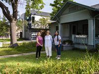 From left, Jeanne Chvosta, Karen Roberts and Sarah Mendoza in front of Roberts' home in the Mount Auburn neighborhood. High property taxes, especially due to new construction such as the house next door to Roberts' home, threaten to push longtime residents out of the area.