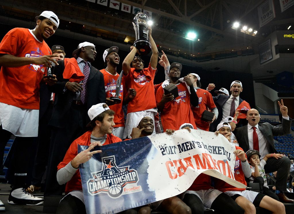 SMU holds up the American Athletic Conference championship trophy after SMU's win against Cincinnati in the NCAA college basketball game in the AAC tournament finals, Sunday, March 12, 2017, in Hartford, Conn. (AP Photo/Jessica Hill)