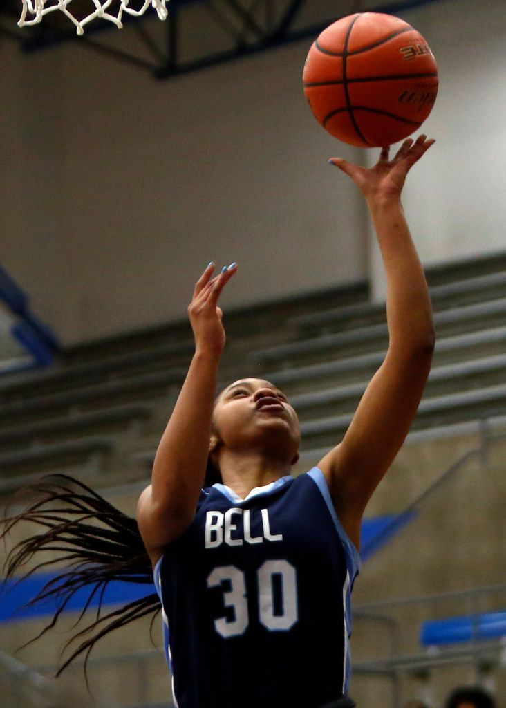 Hurst L. D. Bell's Hallie Rhodes (30) finishes a fast break with a layup during first half action against Arlington Bowie. Bell defeated Bowie, 82-53 to advance. The two teams played their Class 6A bi-district girls basketball game at Grand Prairie High in Grand Prairie on February 17, 2020. (Steve Hamm/Special Contributor).