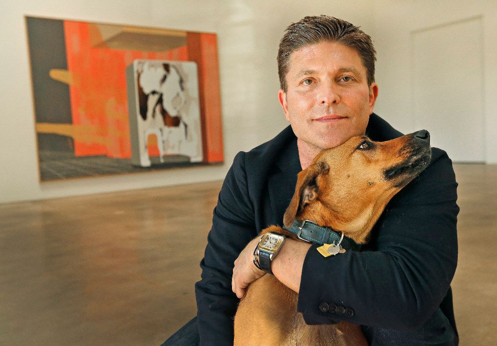 Kenny Goss is pictured with his dog Dixie at the Goss-Michael Foundation in Dallas. (Louis DeLuca/The Dallas Morning News)