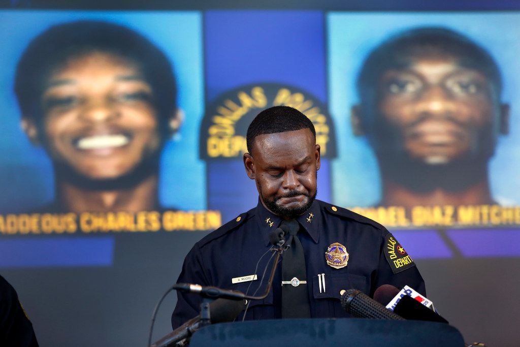Dallas Assistant Chief of Police Avery Moore takes a moment to himself as he offers condolences to Joshua Brown's family during a news conference about his death.  Brown was killed in a drug deal gone bad.