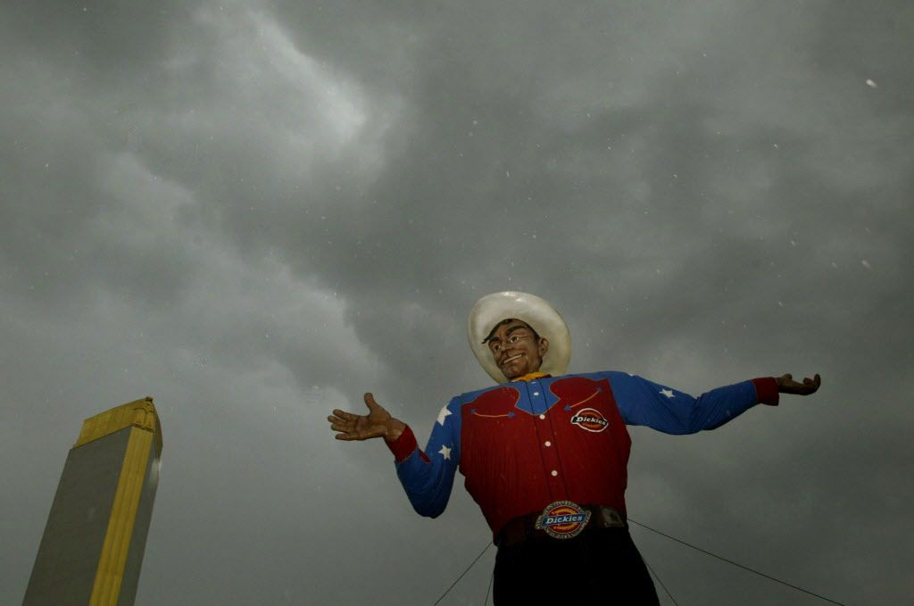 Big Tex stands tall as rain clouds pass overhead in 2007.