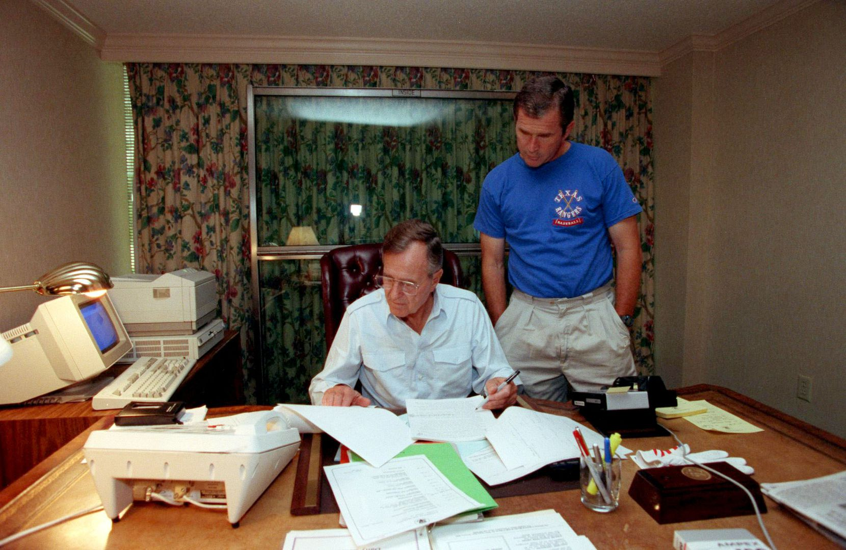 1992: George W. Bush watches at the Houstonian Hotel as his father, President George H. W. Bush, works on his speech to be delivered to the Republican National Convention in Houston. The elder Bush was running for re-election.