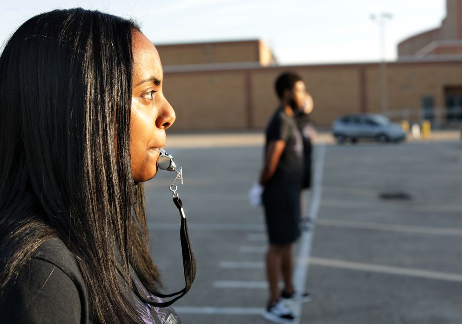 "Junior drum major Aida Ewnetou practices her commands at Berkner High School. Even though class instruction has been through Zoom since spring break, she says, ""We are still laughing together and making new friends even if we aren't in the same room."