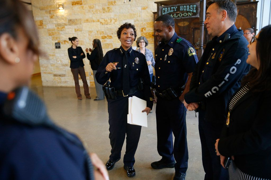 Dallas Police Chief U. Renee Hall (from left) talks to officers Avery Moore and Jimmy Vaughan with Stephanie Neal, Southeast Community Prosecutor, at Texas Horse Park in Dallas on Feb. 20, 2018.