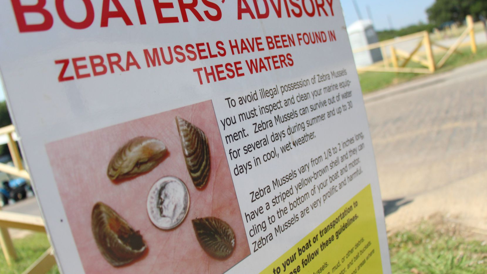 A sign alerting boaters to the presence of zebra mussels is displayed around Lewisville Lake. Boat enthusiasts using any Texas lake or river must clean, drain and dry their watercraft to combat the spread of zebra mussels and other invasive species, the Texas Parks and Wildlife Commission said Thursday, expanding an existing rule to the entire state.