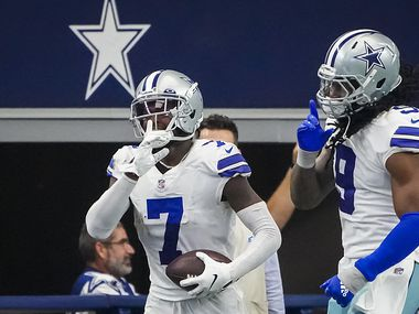 Dallas Cowboys cornerback Trevon Diggs (7) celebrates with middle linebacker Jaylon Smith (9) after intercepting a pass by Carolina Panthers quarterback Sam Darnold, the first of two interceptions for Diggs, during the third quarter of an NFL football game at AT&T Stadium on Sunday, Oct. 3, 2021, in Arlington.