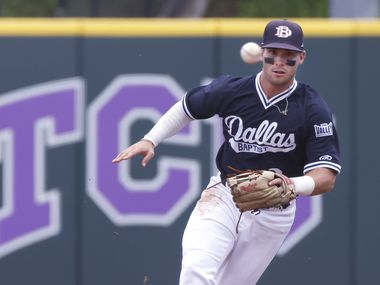 Dallas Baptist infielder Blayne Jones (2) fields a ball off the bat of Oregon St.Õs Wade Meckler (28) before throwing him out at first base in the first inning during the NCAA Division I Baseball Regional Championship game in Fort Worth, Texas on June 7, 2021.