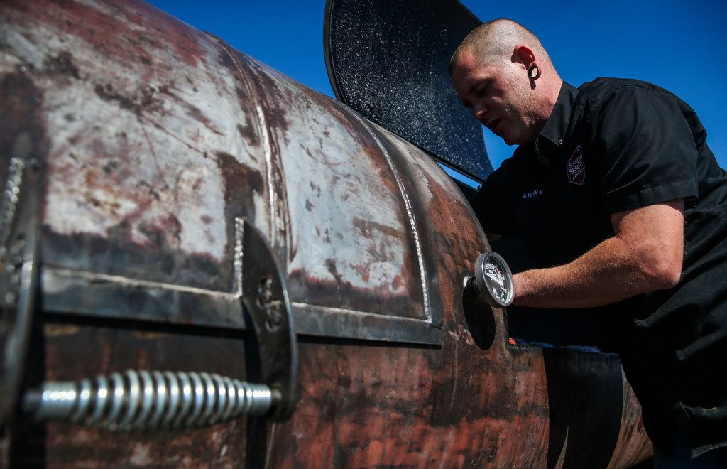 Anthony Potter checks sausages on the smoker at Smoke Sessions Barbecue on Friday, April 20, 2019 in Royse City, Texas. (Ryan Michalesko/The Dallas Morning News)