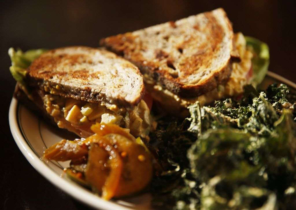 A Vital Farms egg salad sandwich with kale chips at Mudhen