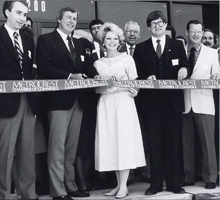 Owners Jack and Dianne Adleta cut the ribbon in 1984 to open their company's new headquarters and distribution center in Carrollton.