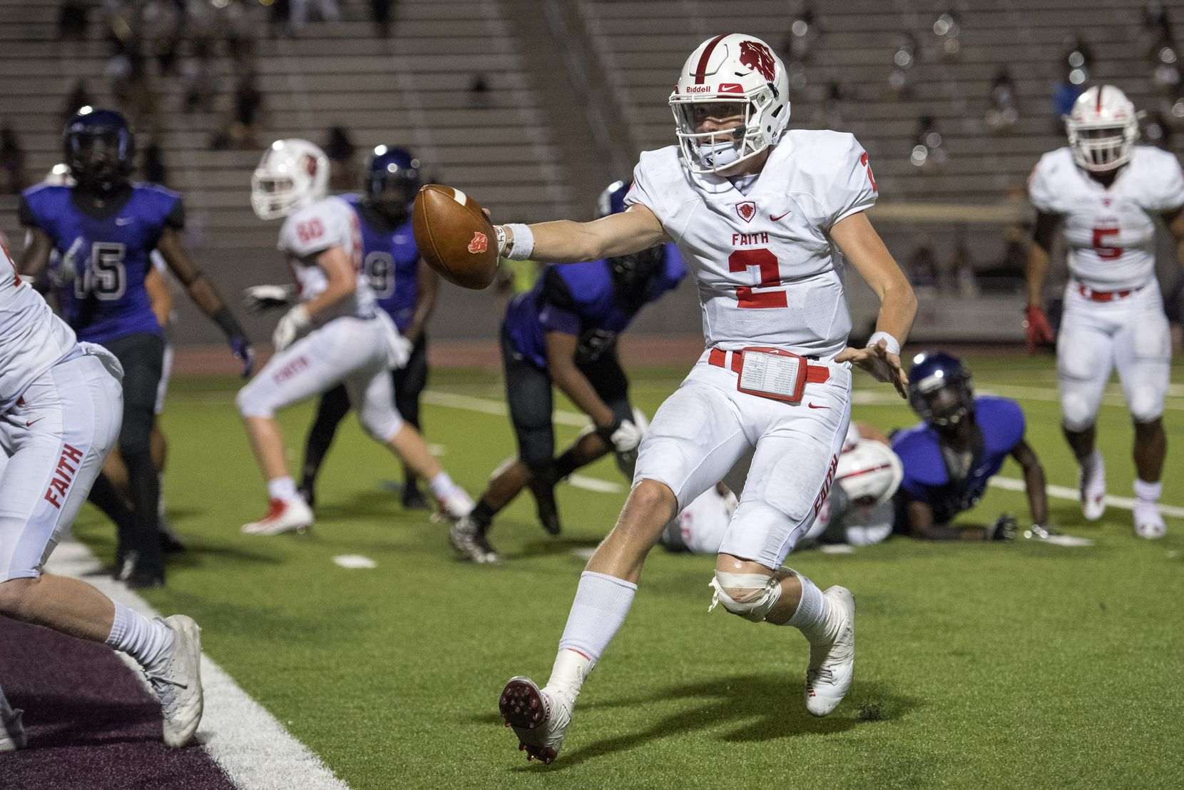 Grapevine Faith quarterback Deuce Hogan (2) extends the ball towards the goal line on a touchdown run against Lincoln in the first half of a high school football game, Friday, September 22, 2017 at John Kincaide Stadium in Dallas. (Jeffrey McWhorter/Special Contributor)