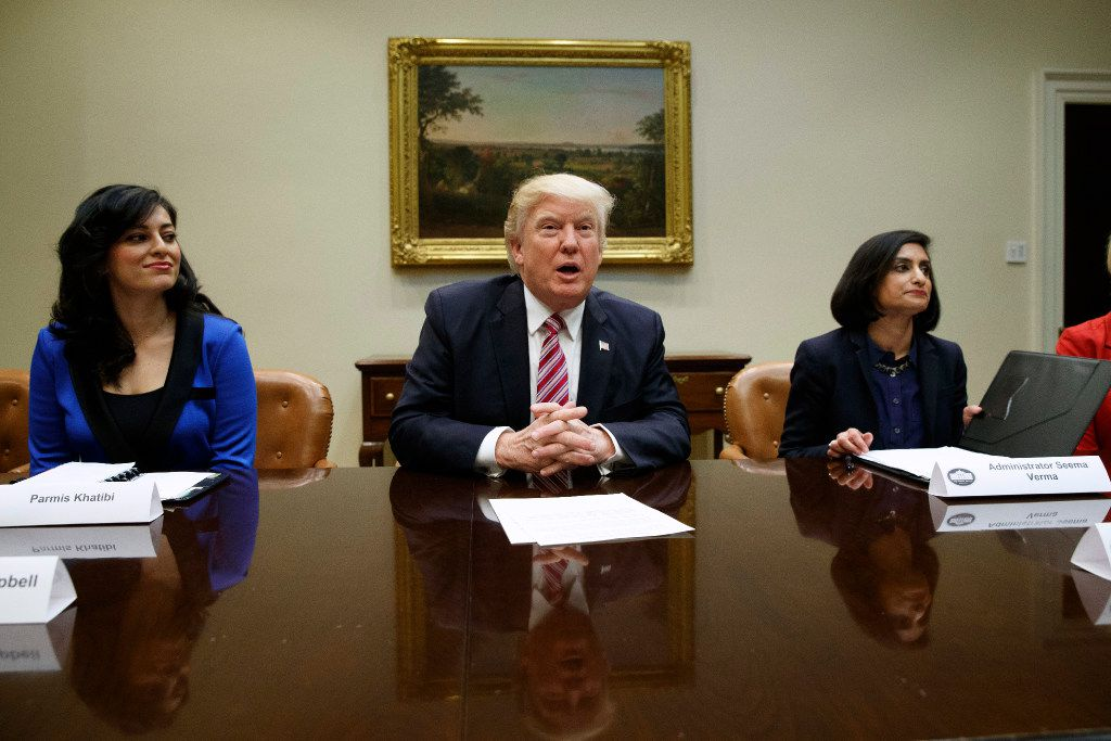 In this March 22, 2017, file photo, President Donald Trump speaks during a meeting on women in healthcare in the Roosevelt Room of the White House in Washington. From left are, Parmis Khatibi, Trump, and administrator of the Centers for Medicare and Medicaid Services Seema Verma. (AP Photo/Evan Vucci, File)