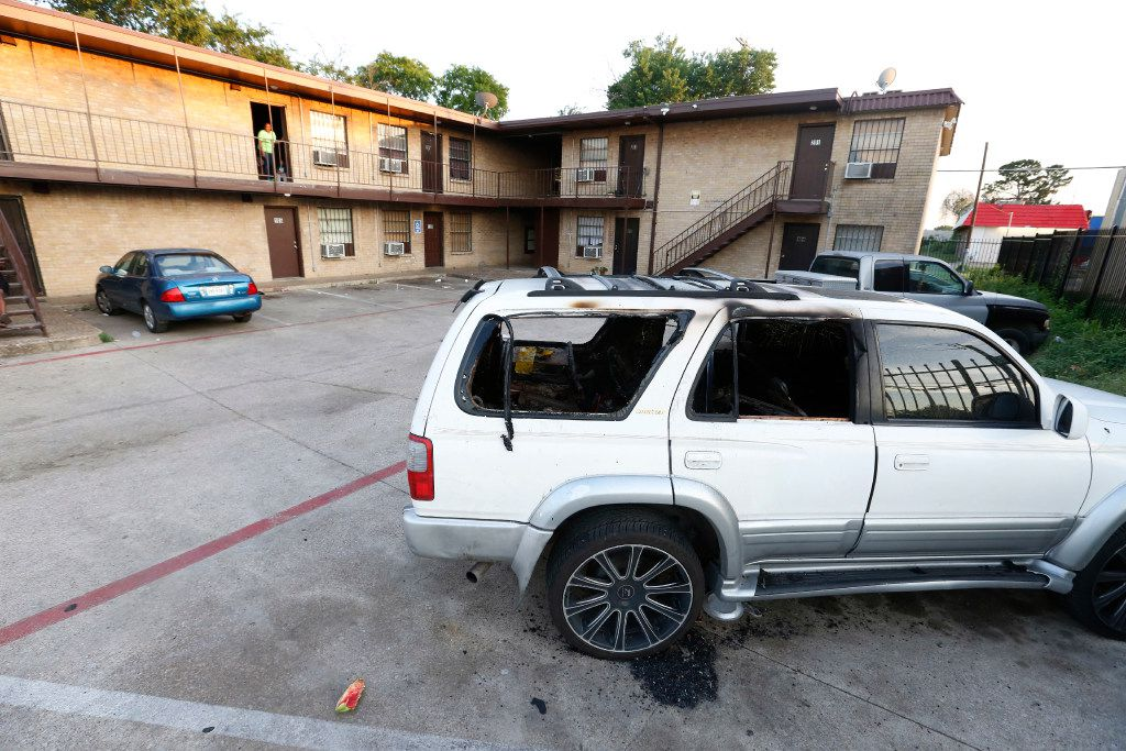 Someone set fire to this Toyota 4Runner, which sits parked in the lot at 3006 Holmes St. in South Dallas.
