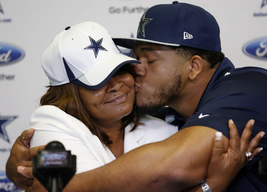 Former LSU offensive lineman La'el Collins kisses his mother, Loyetta Collins, after speaking to the media during a press conference to introduce him as a member of the Dallas Cowboys at Cowboys headquarters in Irving, Texas Thursday May 7, 2015.
