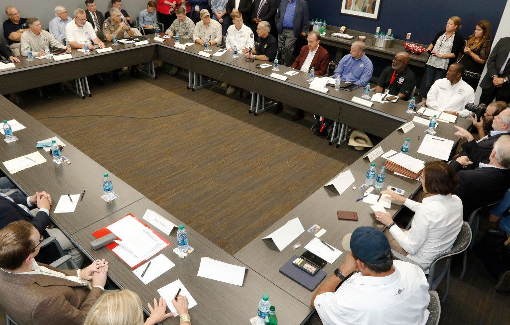 Texas Gov. Greg Abbott (behind the microphone) meets with the Commission to Rebuild Texas at the Victoria College Emerging Technology Complex on Sept. 8 in Victoria.