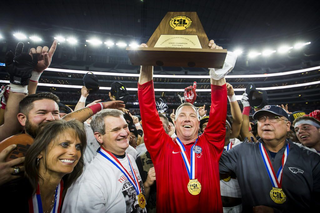 Allen football coach Terry Gambill hoists the championship trophy after the Eagles' 35-33 victory over Austin Lake Travis in the Class 6A Division I state championship game at AT&T Stadium on Saturday, Dec. 23, 2017.