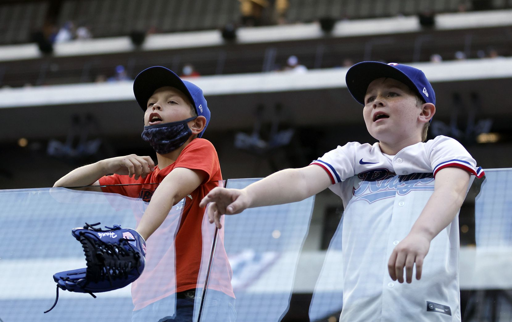 A pair of young Texas Rangers plead for a ball from a Toronto Blue Jays player coming off the field in the eighth inning at Globe Life Field in Arlington, Monday, April 5, 2021. The Texas Rangers were facing the Toronto Blue Jays in their home opener. The Rangers lost, 6-4. (Tom Fox/The Dallas Morning News)