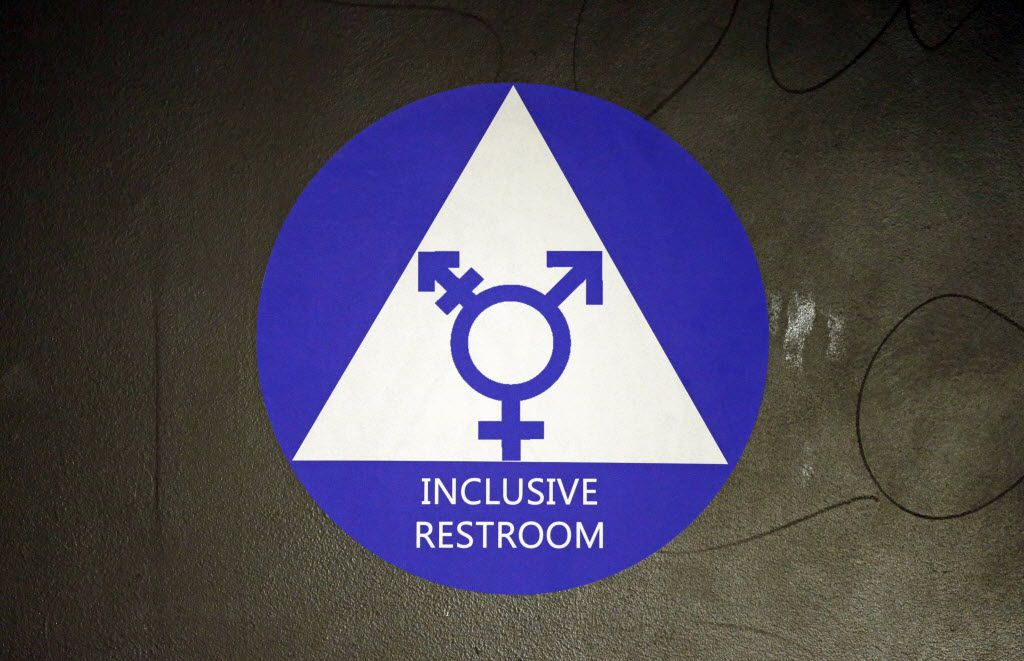 In this May 17, 2016, file photo, a new sticker designates a gender neutral bathroom at Nathan Hale high school in Seattle. (AP Photo/Elaine Thompson)