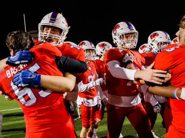 Parish Episcopal's players celebrate their win after winning the TAPPS Division I state football championship game against Fort Worth Nolan at Panther Stadium in Waco on Saturday, Dec. 12, 2020.