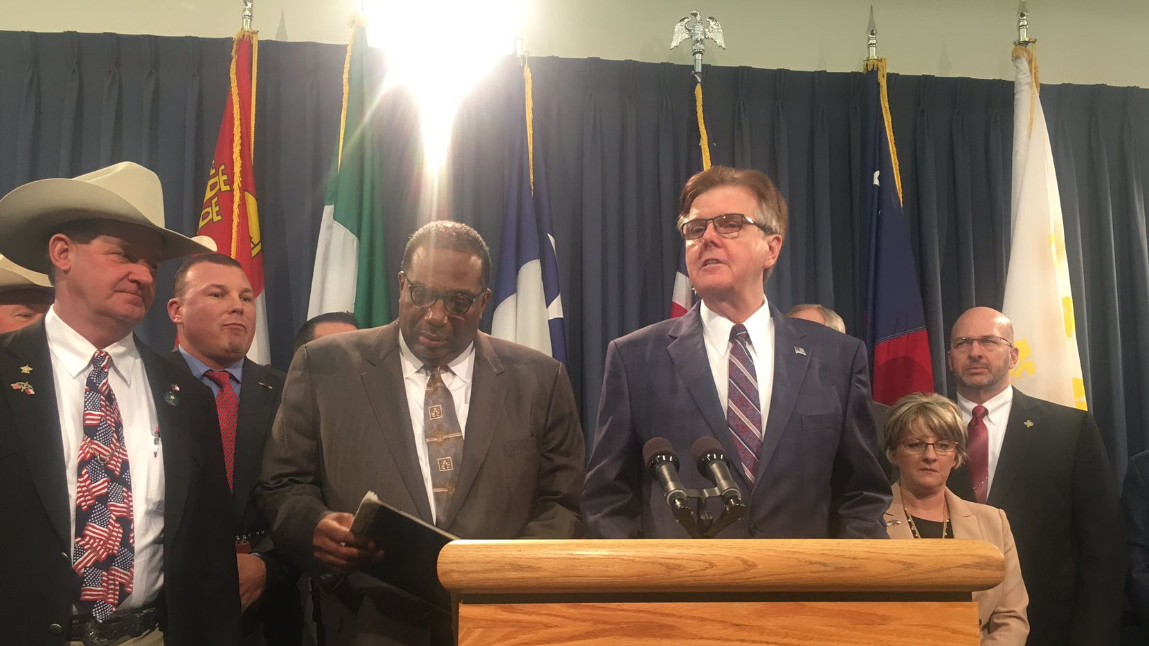 Dallas Sen. Royce West and Lt. Gov. Dan Patrick spoke at a news conference Thursday about a bill that would establish a grant program for law enforcement agencies to purchase stronger protective vests.