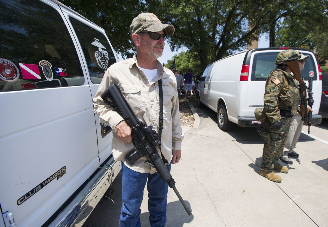 Anti-Shariah protester Jim Rodgers of Fort Worth holds his gun during an anti-Shariah protest and counterprotest Saturday, June 10, 2017, at the intersection of Abrams Road and Centennial Boulevard in Richardson.