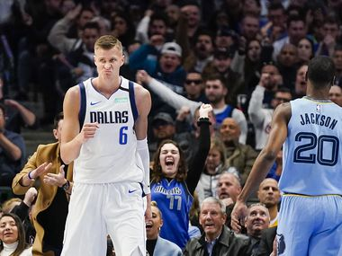 Dallas Mavericks forward Kristaps Porzingis (6) celebrates after scoring past Memphis Grizzlies guard Josh Jackson (20) during the first half of an NBA basketball game at American Airlines Center on Wednesday, Feb. 5, 2020, in Dallas.