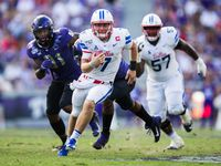 Southern Methodist Mustangs quarterback Shane Buechele (7) runs the ball during the fourth quarter of a college football game between SMU and TCU on Saturday, September 21, 2019 at Amon G. Carter Stadium in Fort Worth.