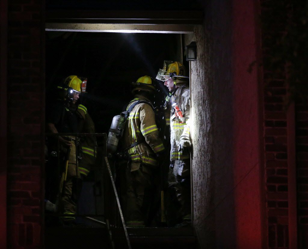 Dallas Fire-Rescue work on putting out a fire after being called to the Landmark at Rosewood Apartments in the 13200 block of Emily Road in Dallas Monday August 8, 2016. (Andy Jacobsohn/The Dallas Morning News)