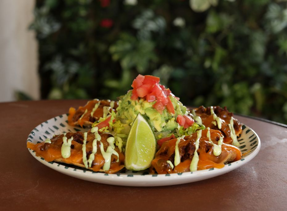 The Nachos Tejanos are a popular order at Mi Cocina. The company operates 21 restaurants in D-FW.