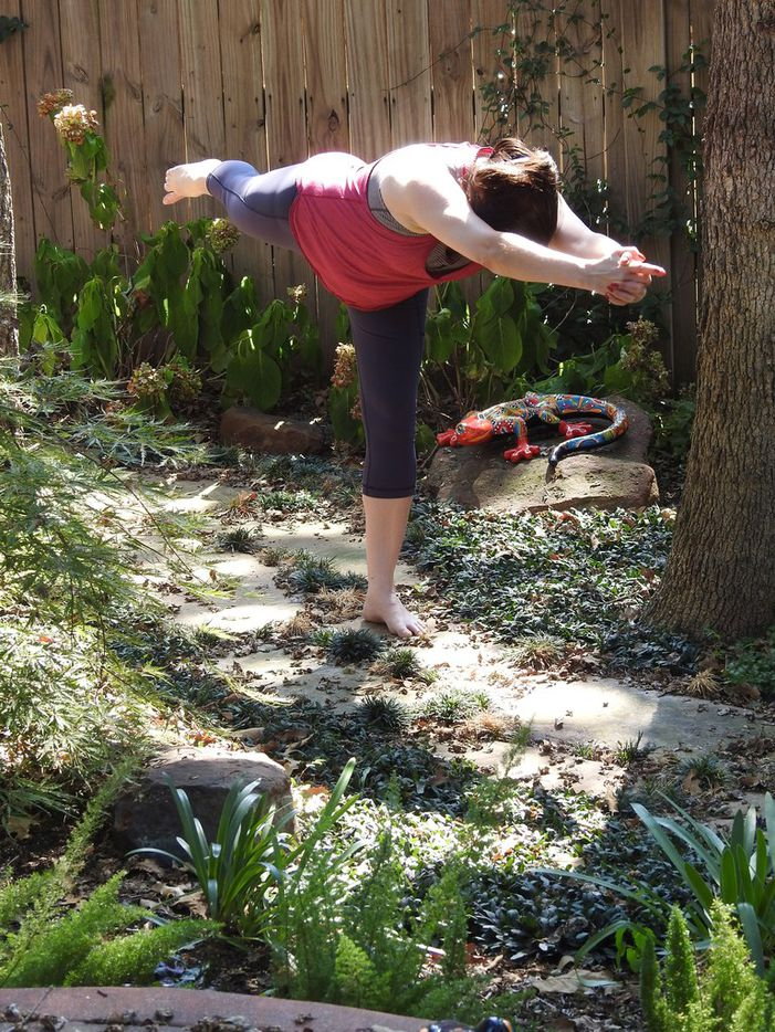 Romelia Flores, IBM distinguished engineer and master inventor, practicing yoga in her backyard garden.