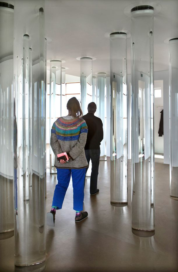 Interior installation detail of glass cylinders holding water from ice of Iceland's major glaciers at artist Roni Horn's Library of Water in Stykkishólmur, Iceland.