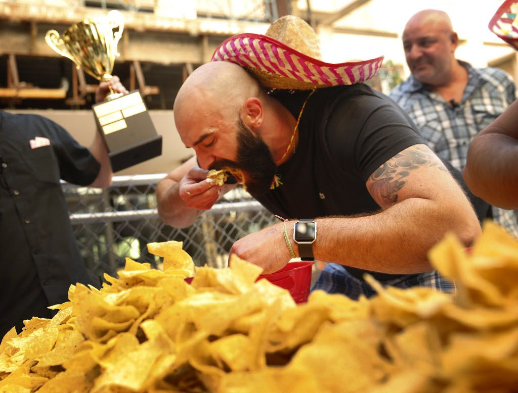 In celebration of Cinco De Mayo, Mattito's restaurant in Uptown area of Dallas held a quest eating competition, Thursday, May 5, 2016. Winner Bradley Johnson, using chips to devour 4 pounds of queso, took the Bob Armstrong Cup and a years worth of queso at the restaurant. (Tom Fox/The Dallas Morning News)