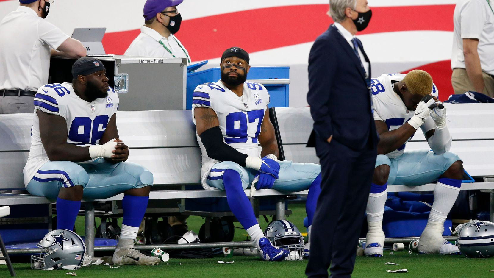 Dallas Cowboys defensive tackle Neville Gallimore (96), Dallas Cowboys defensive end Everson Griffen (97) and Dallas Cowboys defensive end Aldon Smith (58) sit on the bench late in the fourth quarter of play at AT&T Stadium on Monday, October 19, 2020 in Arlington, Texas.