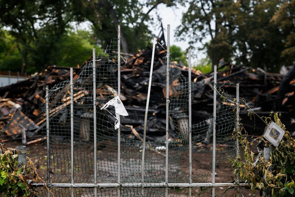 The remains of a historic home, which burned Sunday, is seen at 2426 Pine Street Wednesday in Dallas. The historic home in South Dallas was once a farmhouse belonging to a British family. It was listed on the National Register of Historic Places since 1995.